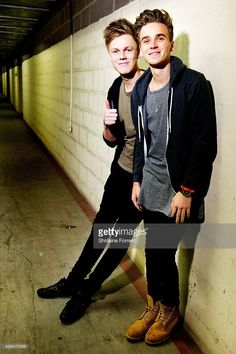 Joe Sugg and Caspar Lee pose backstage before meeting fans to celebrate the release of their new DVD 'Joe