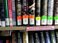 shelf markers directing readers to other similar authors