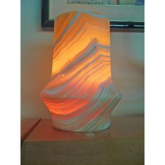 Bring exotic flair to your home decor with this alabaster lamp reminiscent of the legendary lamp of Aladdin. This lamp has an eclectic oriental shape which will provide a spark of magic to any lighting design.