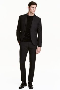 Tuxedo trousers: Tuxedo trousers in woven fabric with a hook-and-eye fastener, stripes down the sides in contrasting fabric, side pockets, welt back pockets and tapered legs. Slim fit.