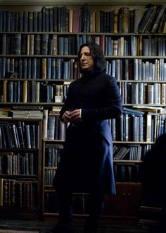 Snape surrounded by his books. Gotta say I loved Snape for all his snarkyness.. plus Alan Rickman is sexy :D