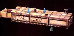Senet Game [center section of game has tree with goats and lions as the gates of the sun]