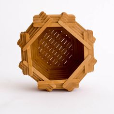 Wooden popsicle stick basket/bowl. Handmade with precision. No actual popsicles were consumed to make this…however, we like to think several wereconsumed while making it. Lid is not pictured, but is included.5″Hx 8.5″Dia.