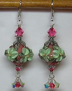 These gorgeous pink and green floral focal beads were made for me by one of my favorite lampwork glass bead artists, Lynn Bauter of Brilynn fame. Her beads are SO worth their price! I complemented them with ornate sterling silver bead caps and sparkling Swarovski crystals. :-) All wire-wrapped together with great patience and care.