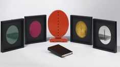 a leather-bound copy of otto hahn's 'portrait d'antonin artaud' (1968) accompanied by metal and plastic oval disks created by lucio fontana were confined within a painted wood sculpture