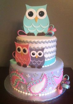 Owl cake. LOVE this; it would be a perfect 1st birthday cake. The colors are awesome...and there's even paisley! Animal theme, dessert