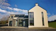 Designed as an evolution of the traditional form and located next to the main Sligo-Donegal road, the super insulated and triple glazed house minimises the noise pollution from the busy road in addition to its energy rating. House Designs Ireland, Noise Pollution, Beautiful Architecture, Architects, Minimalism, House Plans, New Homes, Windows, House Exteriors