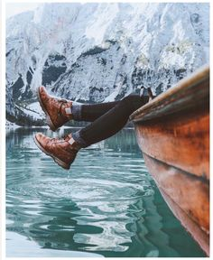 Feet hanging out of a boat