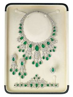 AN EMERALD AND DIAMOND PARURE, BY ELIE CHATILA, Id love to have these pieces displayed on my wall like this!!