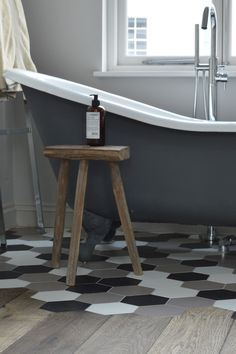This was not the easiest job for our installers, but we think the hard work really paid off. Every single board was meticulously cut to fit around the hexagonal ceramic tiles which form a waterproof area under the bath in this North London guest bedroom. #craftmanship #magmastromboli