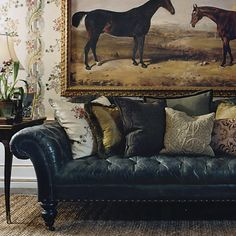 Leather chesterfield sofa . . .decorating with art . . . horses painting . . .