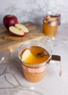 This warm apple Pimms recipe is spiced with orange and cinnamon to create the perfect winter warmer take on Pimms! Pimms Cocktail, Cocktail Recipes, Drink Recipes, Party Recipes, Christmas Snacks, Xmas Food, Christmas Recipes, Christmas Deco, Christmas Cocktail Party
