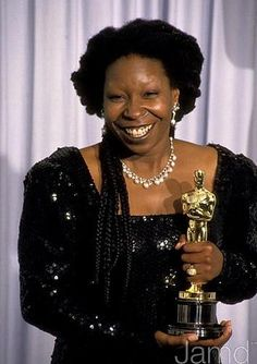 Whoopi Goldberg with the Oscar for Best Supporting Actress for her role in Ghost.