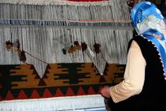 A lady making a traditional carpet by hand. These carpets take months to make and are sold as popular Turkish People, Rug World, Natural Area Rugs, Loom Weaving, Hand Knotted Rugs, Things To Buy, Rugs On Carpet, Oriental, Tapestry