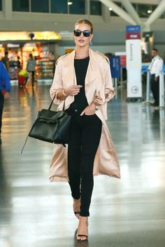 To easily elevate an all-black ensemble like Rosie, style black skinnies with a slinky satin trench. Keep your bag and shoes minimal, adding a hint of glam with thoughtful jewelry.