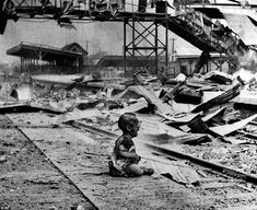 Cry from the centre of destruction: A bloodied child cries in the ruins of Shanghai's Sout...