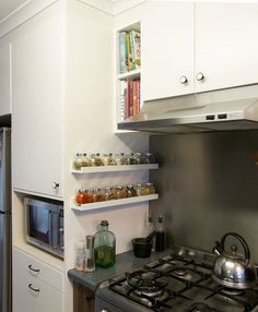 LOVE this for a spice rack! This is an ikea shelf, but the important thing here is the Placement of the spice rack on the cabinet to the side of the stove New Kitchen, Kitchen Dining, Kitchen Decor, Kitchen Cabinets, Kitchen Racks, Studio Kitchen, Cozy Kitchen, Kitchen Shelves, Kitchen Furniture