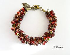 Jana Polackova-Czech Republic  Bracelet 'Late Harvest', small size mushrooms, thorns and some seed beads