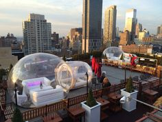 Winter rooftop bar with igloos in New York City