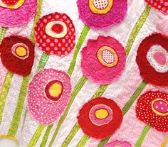 "Poppy baby quilt - wall art quilt- ""Poppy Garden"" in pink, red, yellow, green & white. $190.00, via Etsy."