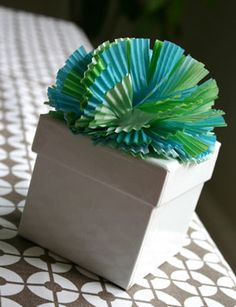 Cupcake Liner Bow. More Projects --> http://blog.hgtv.com/design/2012/07/09/designer-macgyver-totally-sweet-cupcake-liner-crafts/?soc=pinterest