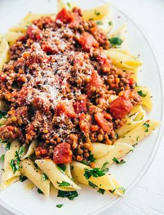 This bolognese is so delicious you won't miss the meat. A meatless version perfect for vegetarians and simple to make. Saute onions with a few vegetables, pour in tomatoes and tomato sauce along with seasoning, simmer and enjoy! Lentil Bolognese, Bolognese Recipe, Food Categories, Recipe Categories, Vegan Pasta, Plant Based Recipes, Pasta Dishes, Lentils, Pasta Recipes