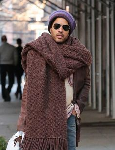 Lenny Kravitz Sports A Very Big Scarf: i started crocheting a white afghan years ago, then stopped. i thought about wearing it as a scarf, but i fell prey to cowardice. now i see what was missing. a nose ring,  and lots of FRINGE! so its going back in my'projects to complete' file