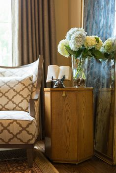 Antiqued Mirror, chair and table to balance the room.