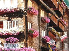 Zermatt, Switzerland. The beautiful pink and white flowers in the window boxes add to the enchanting-charm of a very dreamy place.  switzerland Places to Visit  हमारी साइट पर सूचना   https://storelatina.com/switzerland/travelling  #recetas #switzerlandfood #recipesswitzerland #switzerlandtravel