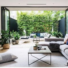 gorgeous 40 Fabulous Indoor Outdoor Living Spaces Design Ideas That You Need To Try Living Room Designs, Living Room Decor, Living Spaces, Estilo Interior, Casa Loft, Indoor Outdoor Living, Outdoor Rugs, Beautiful Living Rooms, Minimalist Living