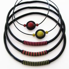 Halsband, gummi, o-ringar och polarispärlor. Necklaces, rubber, o-rings and polaris beads.