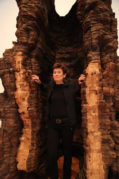 Ursula von Rydingsvard stands next to one of her colossal sculptures. As a child growing up in post-World War II Germany, Ursula von Rydingsvard remembers playing on the grounds of a bomb-leveled building where she would pick up scattered bricks and then stack them around her body like a cocoon. It was an escape from the chaos around her.
