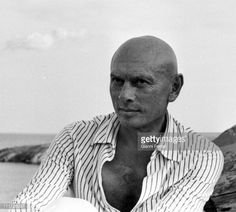 Yul Brynner with a dog on the Catalan coast during a break from filming of the movie 'The Light of the Edge of the World', 1971, Cadaques, Spain