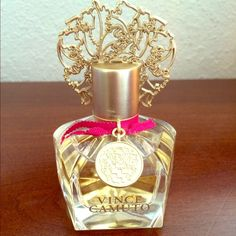 Vince Camuto fragrance This delicately adorned glass bottle of Vince Camuto fragrance is not just pretty on your dresser. Created as a chypre-floral, Vince's top notes are enriched with intoxicating notes of rum absolute and osmanthus nectar. The heart is opulent and floral, composed of Bulgarian rose and night blossoming jasmine enhanced with leather notes, while a base incorporates vanilla, absolute, sensual patchouli, hot Brazilian amber and leathery musk. This fragrance is a perfect day…