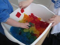 Rainbow sensory tub made from gelatin.  Visit pinterest.com/arktherapeutic for more #sensoryplay ideas