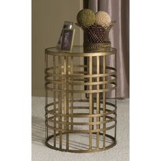 @Overstock.com - Weave Metal Barrel End Table - Strength and sophistication combine in this contemporary and stylish barrel table, complete with an antique gold finish, woven metal accents and an airy design.    http://www.overstock.com/Home-Garden/Weave-Metal-Barrel-End-Table/7910657/product.html?CID=214117 $109.79