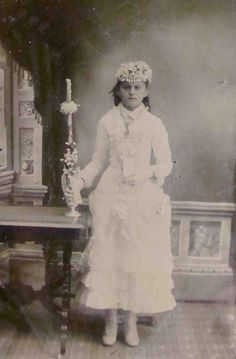 Beautiful photo of standing post mortem girl. Note the holding stand behind her, barely visible behind her feet.