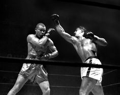 Rocky Marciano and Joe Louis battle it out at Madison Square Garden in 1951.  It was Louis' last professional fight.