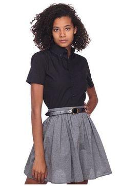Grey skater skirt, black short-sleeved button-down.