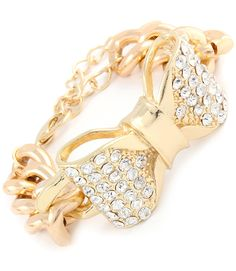 Beautiful statement bracelet designed with an over-sized, tied ribbon embellished with crystal studs set on a link...