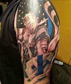 Police tattoo. 1 asterisk tattoo, thin blue line tattoo. American Flag tattoo.