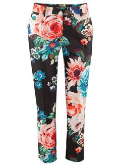 H floral print trousers, £12.99  Bored of your plain tailored work trousers? Then we have just the thing for you. This floral print