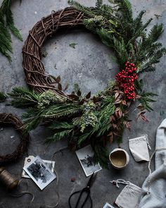 suchlovelylittlefinds:  A wreath of foraged bits & evergreen. These traditions we have, these little gestures of life & celebration in the heart of winter mean more than tis the season for spiced cakes & shopping. This time of year has long been a celebration of the inevitable return of life after the dead of winter. And the evergreen wreath is a beautiful symbol of it. The snake eating it's tale, the seasons, eternal return—maiden, mother, crone.   wreath by @fieldandflora #wint...