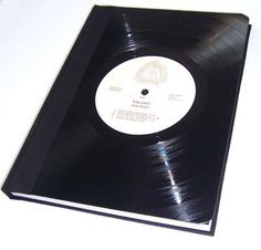 Vinyl Record Book Cover! A great way to make your favorite book's life longer while recycling old vinyl record!