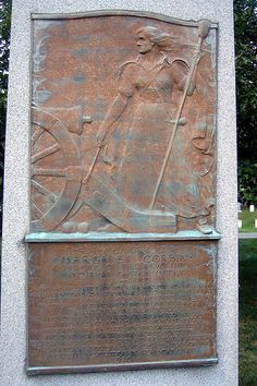 """The grave of Margaret """"Captain Molly"""" Corbin at West Point, New York. On 11/16/1776, a private in the PA Artillery, John Corbin, was killed during a battle at Ft Washington, NY. His wife, Molly, who refused to let her husband go to war alone, was by his side, and when he fell, quickly took his place at the cannon. She was severely wounded by gunfire in her arm and chest, incapacitating her for life. For her heroic actions, she became the first woman pensioner of the United States in 1779."""