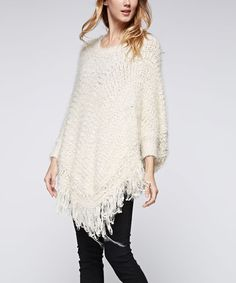 This Ivory Fuzzy Fringe Poncho is perfect! #zulilyfinds