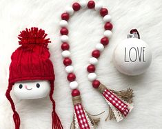 farmhouse red & white wooden bead garland with high wrapped tassels. Handcrafted with painted wooden beads, hemp cord, ribbon, & jute. This listing is for the garland only. Christmas Bead Garland, Wood Bead Garland, Diy Garland, Beaded Garland, Christmas Ornaments, Garlands, Garland Ideas, Xmas, Christmas Decor