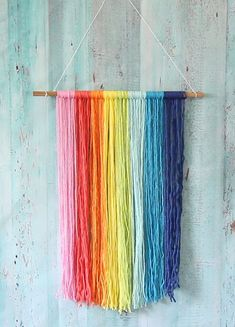 Rainbow Macrame Wall Hanging Rainbow colored yarn and giant paper flowers make u… - DIY FLOWERS Rainbow Paper, Rainbow Crafts, Rainbow Wall, Rainbow Room Kids, Yarn Wall Art, Yarn Wall Hanging, Wall Hanging Crafts, Wall Hangings, Paper Wall Decor