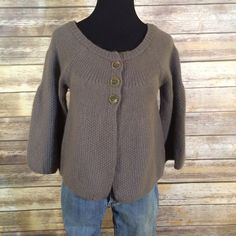 Free People 3 button cardigan bell sleeves Free People 3 button cardigan bell sleeves. Brass tone buttons with olive green stitching. Slight bell shape sleeve. Good condition. Slight piling under arms. Not noticeable. No holes or stains. Soft lambs wool/angora/nylon knit combo. Free People Sweaters Cardigans