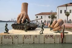 Life-Size Installations of Hands Playing with Toys - My Modern Metropolis